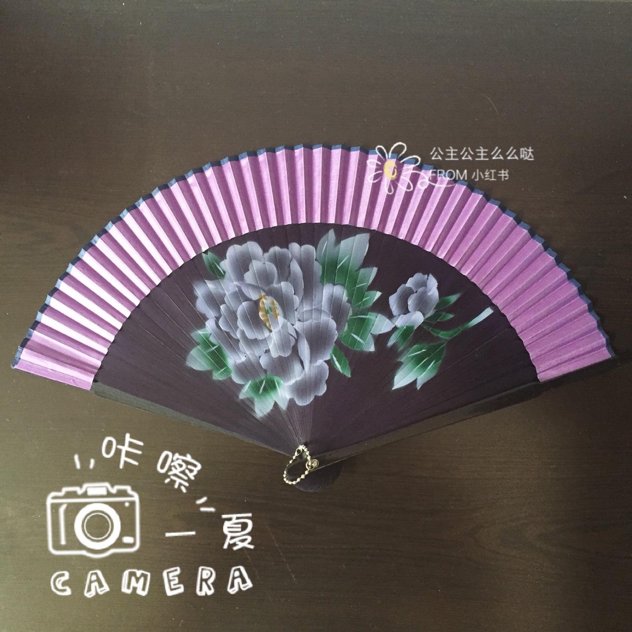 折扇桃花林的手绘图片